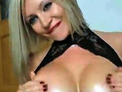 Busty Blonde Milf Oils Up Her Glorious Rack On Webcam