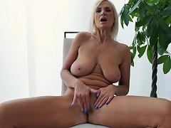 Mature Blonde Opens Her Legs To Reveal Her Bald Cunt